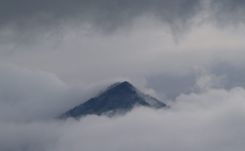 Cloud covered mountain in BC by Craig Bennett